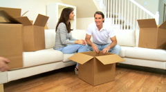 Family with Moving Home Cartons to be Unpacked - stock footage