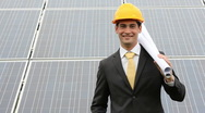 Engineer at solar power station Stock Footage