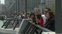 Shanghai Bund people looking at the riverside view - stock footage