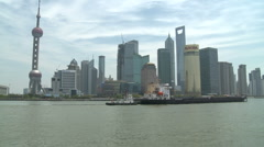 Shanghai Pudong and Huangpu river boat passing - stock footage