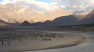 Indus river and mountain ranges in Pakistan Stock Footage