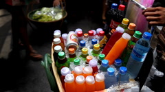 Cold water and juices on selling on the streets of Bangkok, Thailand Stock Footage