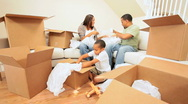 Stock Video Footage of Happy Family Unpacking After House Move