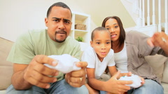 Young Family Competing on a Games Console - stock footage