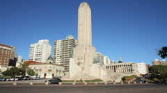 Flag monument time lapse city of Rosario, Argentina with traffic and pedestrians Stock Footage