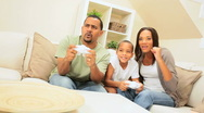 Ethnic Family Competing on a Games Console Stock Footage