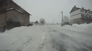 Driving car on snow - back view 01 Stock Footage