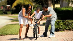 Cute Young Ethnic Boy on Bicycle - stock footage