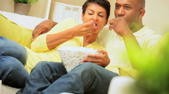 Ethnic Couple Watching Scary Movie with Popcorn Stock Footage