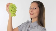 Woman eating grapes Stock Footage