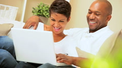 Young Ethnic Couple Using Laptop at Home Stock Footage