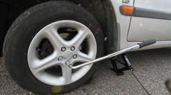 Tightening wheel nuts Stock Footage