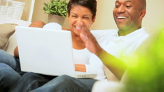 Ethnic Couple Using Interactive Technology - stock footage
