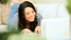 Young Girl Relaxing With a Book Stock Footage