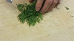 Man Chops Dill Stock Footage