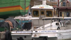 Fishingboat in harbor Stock Footage