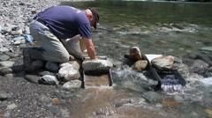 Miner ,river sluice box Stock Footage