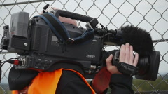 HD720p50 TV Cameraman with Broadcast Camera Stock Footage