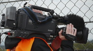 Stock Video Footage of HD720p50 TV Cameraman with Broadcast Camera