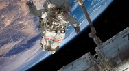 Stock Video Footage of Astronaut Working on International Space Station