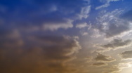 Time-lapse clouds in blue and orange sky. Stock Footage