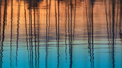 Reflection of yacth poles from colorful calm sea. Stock Footage