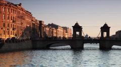 House and Bridge Lomonosov at canal illuminated by setting sun in center St. Stock Footage