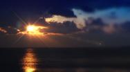 Sunset on deep blue cloudy sky, sea. Stock Footage
