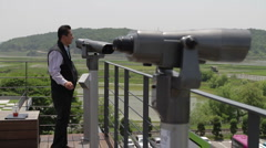 DMZ Panmunjon North Korean border tourists at sight seeing spot Stock Footage