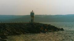 Lighthouse near harbor. - stock footage