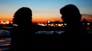 Stock Video Footage of Silhouettes two girls sitting and talking on deck of ship sailing