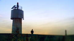 Man walking from lighthouse. - stock footage