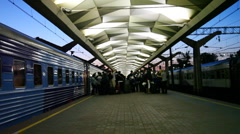 Moscow railway station platform with passengers and train Stock Footage