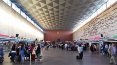 Commuters walk in railway station Moskovskaya. Stock Footage