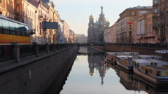 River channel with boats and Church of Savior on Spilled Blood far away Stock Footage