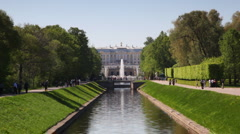 Stock Video Footage of Alley of trees and channel in middle front Royal Petrodvorets