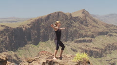 Fitness in volcanic mountains Stock Footage
