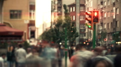 Time-lapse people crossing across busy traffic in downtown. - stock footage