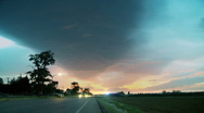 Time-lapse busy traffic and storm clouds in blue sky. Stock Footage