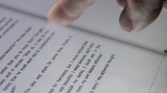 Book on a touch screen tablet computer. (5) w/ highlighting Stock Footage