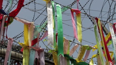 DMZ Panmunjon North Korean border ribbons attached to barber fences Stock Footage