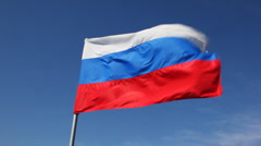 Big Russian tricolor flag flutters in wind Stock Footage