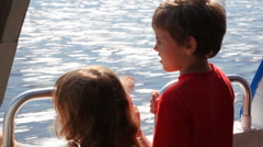 Boy and his sister float fast moving boat hydrofoil on sea Stock Footage