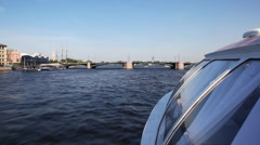 Hovercraft floating rapidly under Brokerage bridge on Neva River in direction of - stock footage