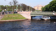 Stock Video Footage of Boat floats under 2-nd Garden Bridge over channel in center of St. Petersburg