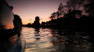 Stock Video Footage of Boat floating on river lit night sky