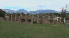 Amiternum Roman ruins in Italy with mountains Stock Footage