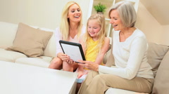 Three Generations of Females with Wireless Tablet Stock Footage