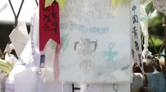 DMZ Panmunjon North Korean border ribbons and drawings attached to barber fences Stock Footage