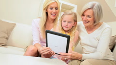 Cute Little Grand-daughter Being Shown a Wireless tablet Stock Footage